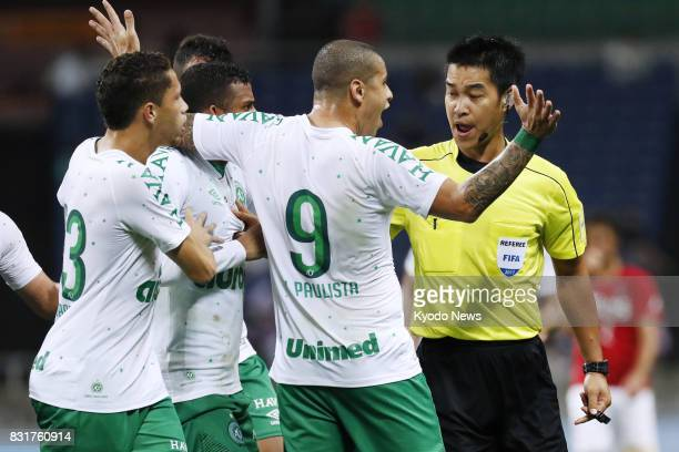Players of Brazil's Chapecoense argue with the referee after a penalty was awarded to Japan's Urawa Reds two minutes to time in the Suruga Bank...
