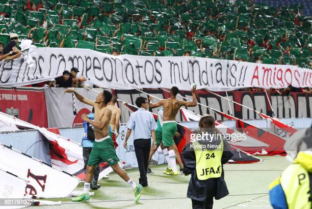 Players of Brazil's Chapecoense react to banners written in Portuguese at Saitama Stadium in Saitama Japan after a 10 loss to Urawa Reds in the...