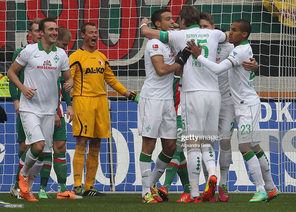 Players of Bremen celebrate their first goal as goalkeeper <a gi-track='captionPersonalityLinkClicked' href=/galleries/search?phrase=Alexander+Manninger&family=editorial&specificpeople=167082 ng-click='$event.stopPropagation()'>Alexander Manninger</a> of Augsburg shouts out during the Bundesliga match between FC Augsburg and Werder Bremen at SGL Arena on February 1, 2014 in Augsburg, Germany.