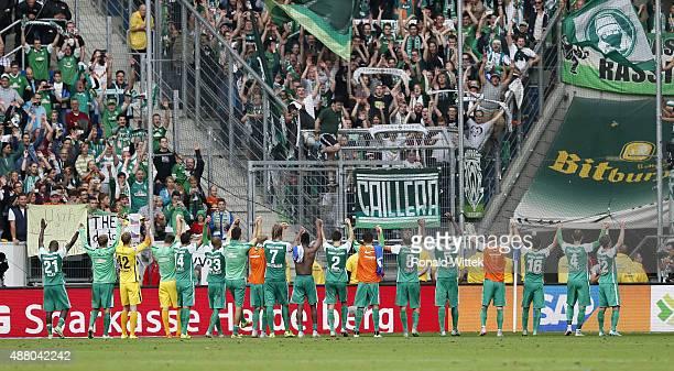 Players of Bremen celebrate with supporters after the Bundesliga match between 1899 Hoffenheim and SV Werder Bremen at Wirsol RheinNeckarArena on...