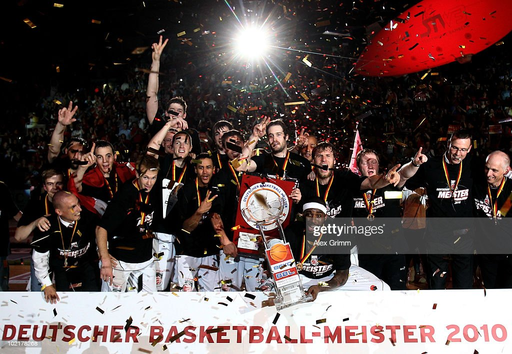 Players of Brose Baskets celebrate the German Championship after winning game five of the Beko Basketball Bundesliga play off finals against Deutsche Bank Skyliners at the Jako-Arena on June 17, 2010 in Bamberg, Germany.