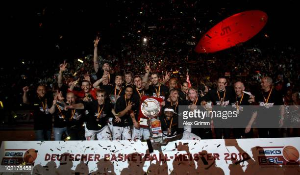 Players of Brose Baskets celebrate the German Championship after winning game five of the Beko Basketball Bundesliga play off finals against Deutsche...