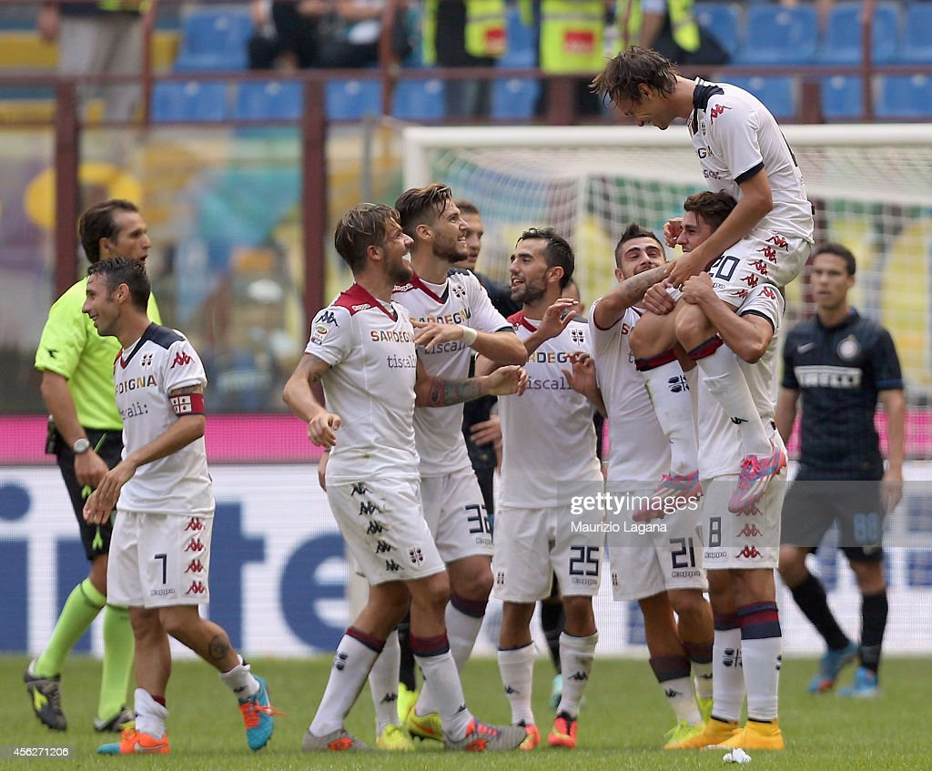 Players of Cagliari celebrate during the Serie A match between FC Internazionale Milano and Cagliari Calcio at Stadio Giuseppe Meazza on September 28...