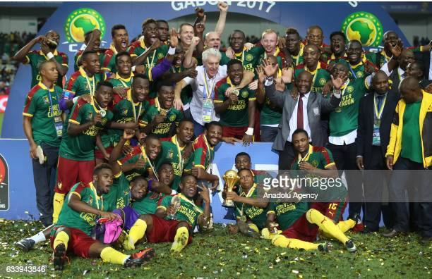 Players of Cameroon celebrate during the awards ceremony after winning the final match in 2017 Africa Cup of Nations at the d'Angondje Stadium in...