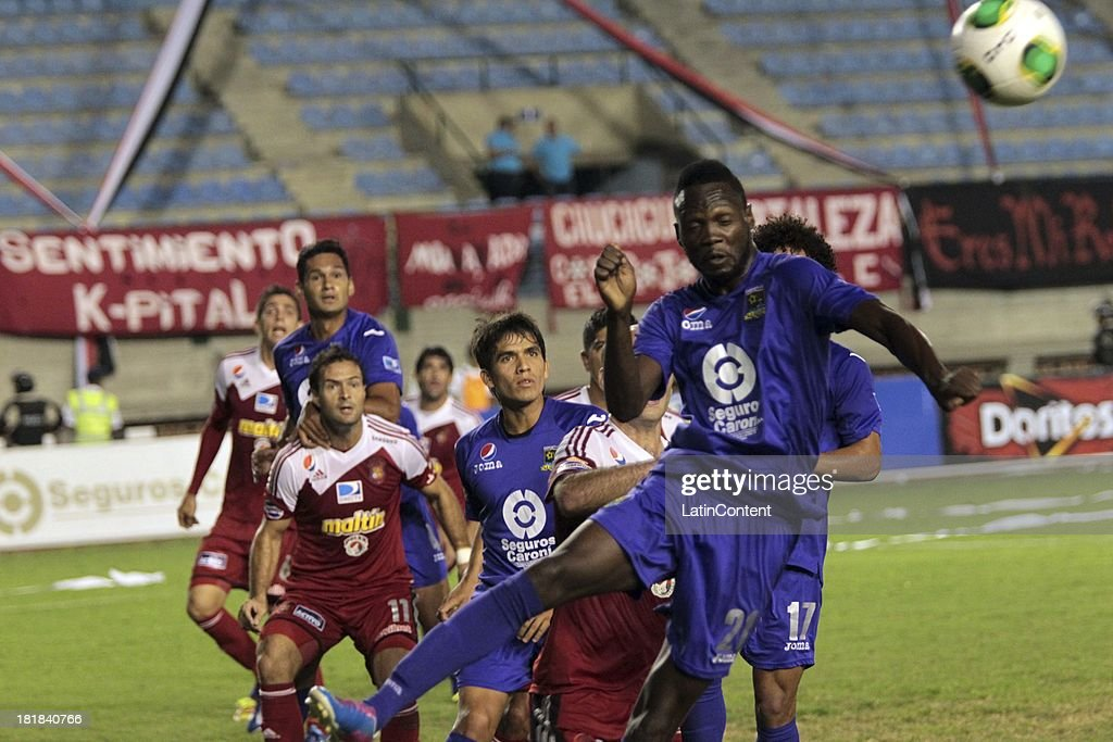 Players of Caracas FC and Deportivo La Guaira in action during a match between Caracas FC and Deportivo La Guaira as part of the Apertura 2013 at Brígido Iriarte Stadium on September 25, 2013 in Caracas, Venezuela.