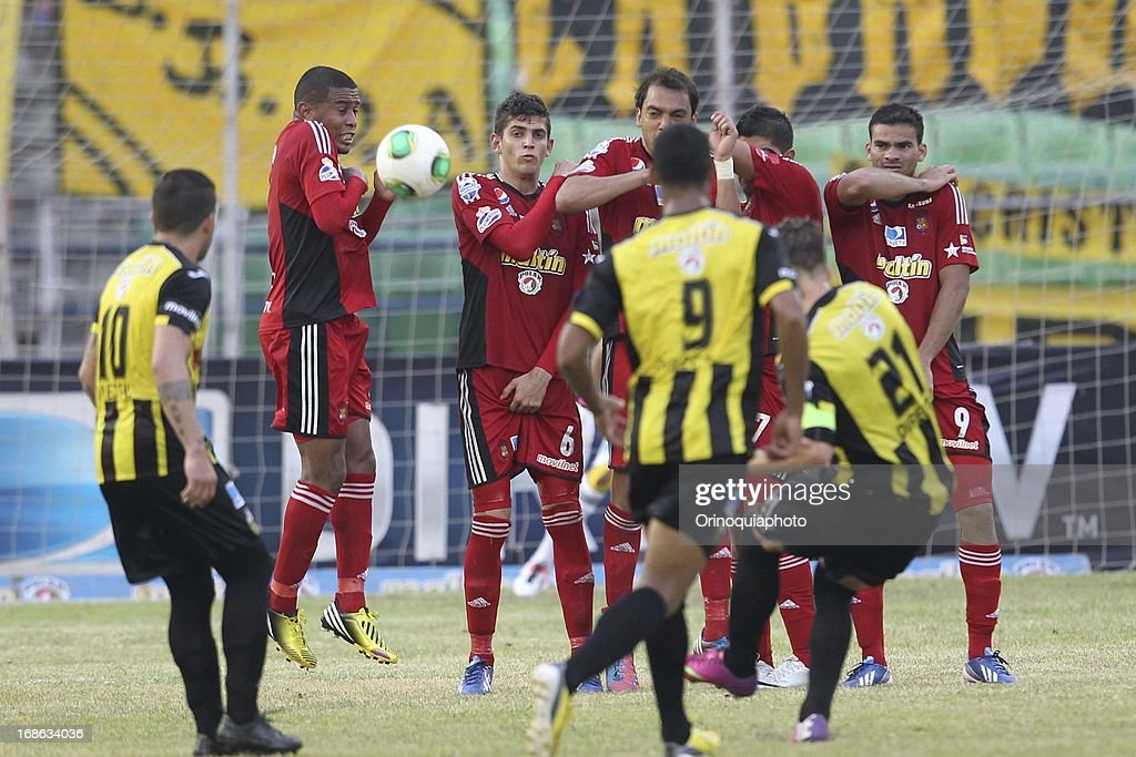 Players of Caracas FC in action during a match between Caracas FC and Deportivo Tachira as part of the Torneo Clausura 2013 at Olympic stadium on May 12, 2013 in Caracas, Venezuela.