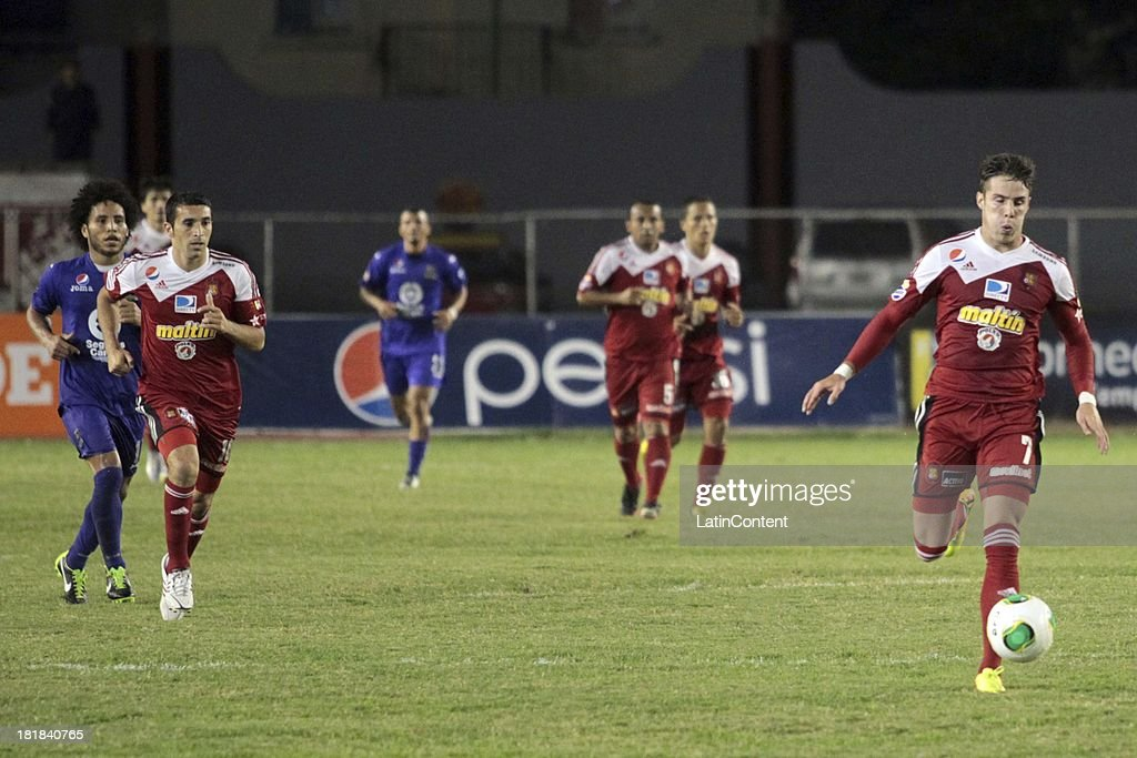 Players of Caracas FC in action during a match between Caracas FC and Deportivo La Guaira as part of the Apertura 2013 at Brígido Iriarte Stadium on September 25, 2013 in Caracas, Venezuela.