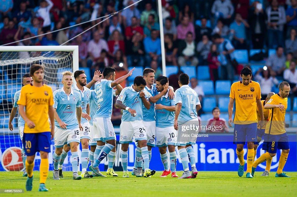 Players of Celta Vigo congratulate their teammate Manuel Agudo 'Nolito' scored the opening goal during the La Liga match between Celta Vigo and FC...
