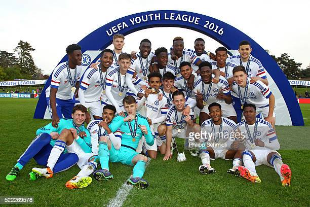 Players of Chelsea FC celebrate victory with the UEFA Youth League trophy after the UEFA Youth League Final match between Paris Saint Germain and...