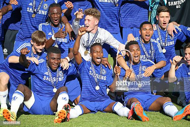 Players of Chelsea FC celebrate with the Lennart Johansson trophy after the UEFA Youth League Final match between Shakhtar Donetsk and Chelsea FC at...