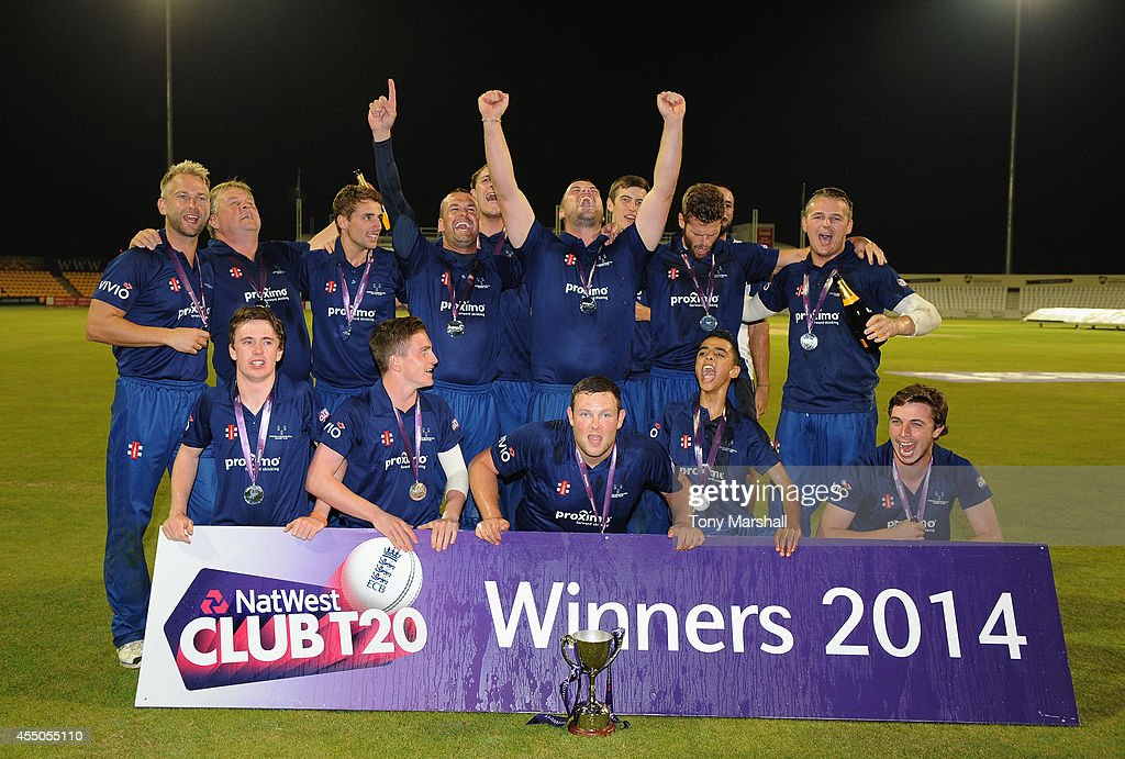 Players of Chester Boughton Hall celebrate winning the final between Chester Boughton Hall Cricket Club and Ashtead Cricket Club during the ECB...