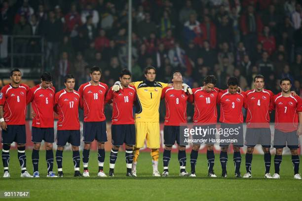 Players of Chile and Slovakia observe a minute of silence in memory of German goalkeeper Robert Enke prior to the international friendly match...