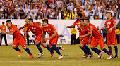 Players of Chile celebrate after Francisco Silva scored the winning penalty during the championship match between Argentina and Chile at MetLife...