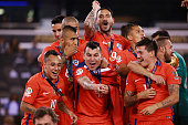 Players of Chile celebrate after winning the championship match between Argentina and Chile at MetLife Stadium as part of Copa America Centenario US...