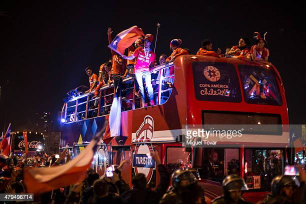 Players of Chile celebrate on the open top bus after winning the 2015 Copa America Chile Final match between Chile and Argentina at Nacional Stadium...