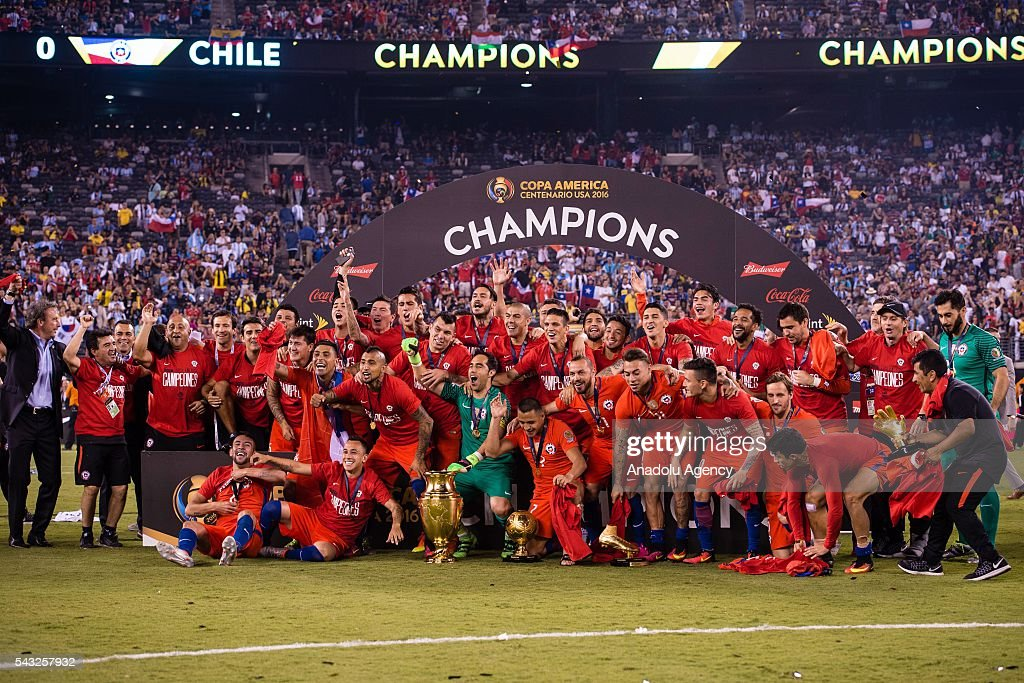 Players of Chile celebrate with the trophy after the championship match between Argentina and Chile at MetLife Stadium as part of Copa America Centenario 2016 on June 26, 2016 in East Rutherford, New Jersey, USA.