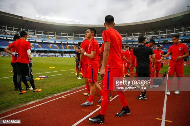 Players of Chile enter to the field to warm up during the FIFA U17 World Cup India 2017 group F match between Chile and England at Vivekananda Yuba...