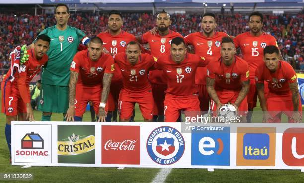 Players of Chile pose for pictures before the start of their 2018 World Cup football qualifier match against Paraguay in Santiago on August 31 2017...