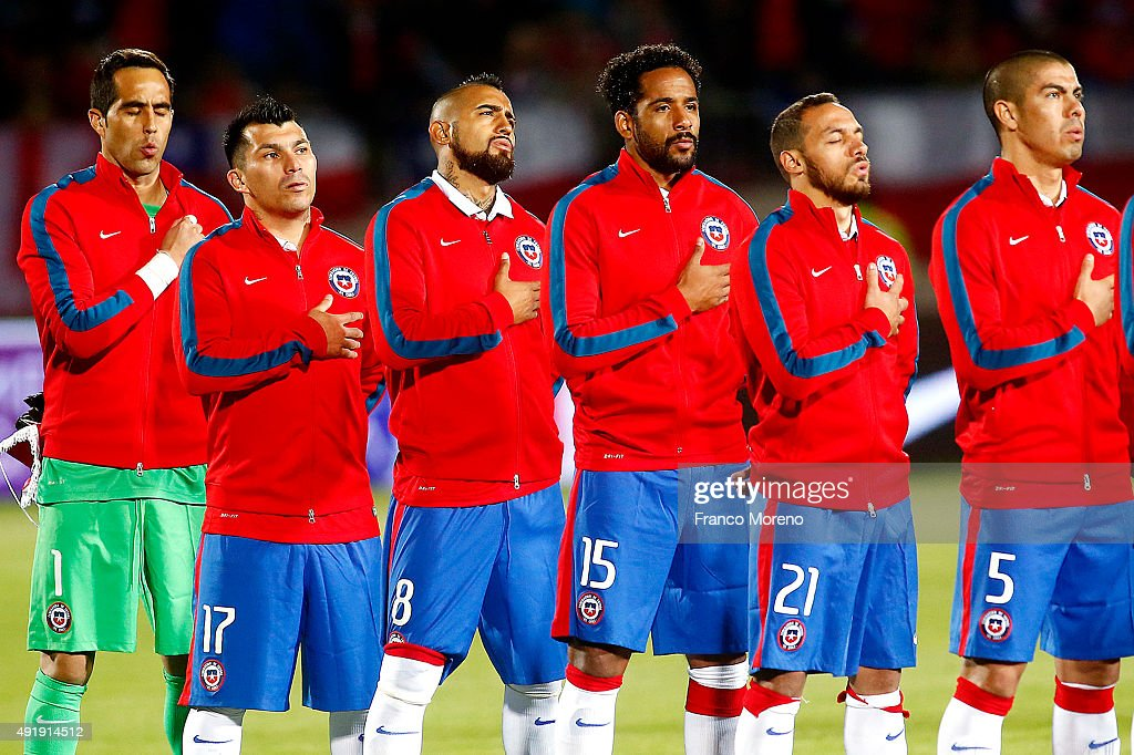 Players of Chile sing their national anthem prior to a match between Chile and Brasil as part of FIFA 2018 World Cup Qualifier at Estadio Nacional on October 08, 2015 in Santiago, Chile.