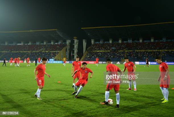 Players of Chile warm up prior to the FIFA U17 World Cup India 2017 group E match between Mexico and Chile at Indira Gandhi Athletic Stadium on...