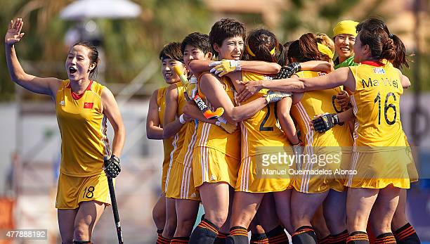 Players of China celebrate after the winning the match between Argentina and China at Polideportivo Virgen del Carmen during day seven of the Hockey...