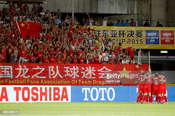 Players of China celebrate after they win a goal against Japan during the EAFF East Asian Cup 2015 final round at the Wuhan Sports Center Stadium on...