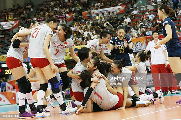 Players of China celebrate after win in a match against Russia during the FIVB Women's Volleyball World Cup Japan 2015 at Nippon Gaishi Hall on...