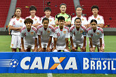 Players of China pose for photo before a match between USA and China as part of International Women's Football Tournament of Brasilia at Mane...