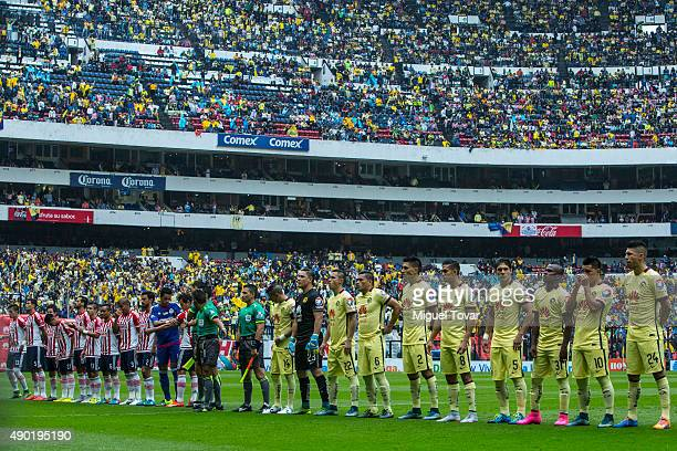 Players of Chivas and America look on prior a 10th round match between America and Chivas as part of the Apertura 2015 Liga MX at Azteca Stadium on...