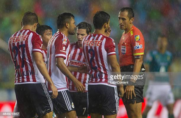 Players of Chivas argue with referee Luis Enrique Santander during a 6th round match between Leon and Chivas as part of the Apertura 2015 Liga MX at...