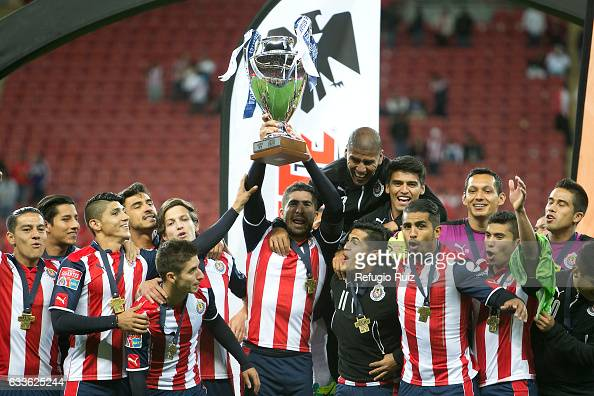 Players of Chivas celebrate with the trophy of the Duelo de Gigantes after a friendly match between Chivas and Boca Juniors at Chivas Stadium on...