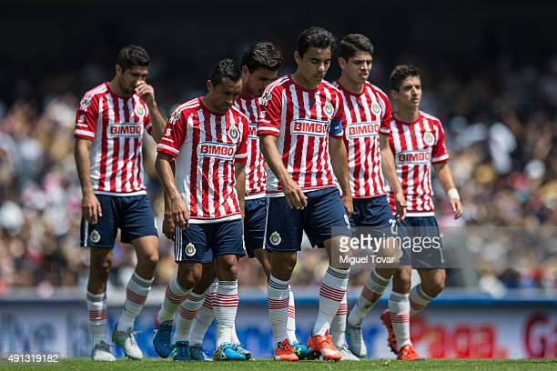 Players of Chivas leave the field after losing a 12th round match between Pumas UNAM and Chivas as part of the Apertura 2015 Liga MX at Olimpico...