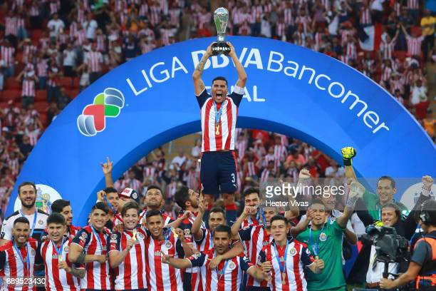 Players of Chivas lift the champions trophy after the Final second leg match between Chivas and Tigres UANL as part of the Torneo Clausura 2017 Liga...