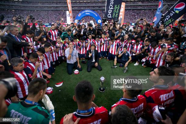 Players of Chivas pray after winning the championship during the Final second leg match between Chivas and Tigres UANL as part of the Torneo Clausura...