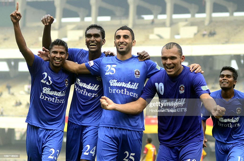 Players of Churchill Brothers celebrate their win against East Bengal during I-League Football Match, at Yuba Bharati Krirangan, on January 19, 2013 in Kolkata, India.