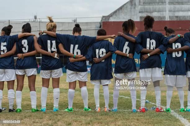Players of Cidade de Deus football team lineup for the penalty shootout during the Women's Favelas Cup football final at Conselheiro Galvao stadium...