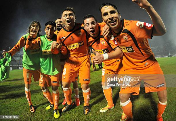Players of Cobreloa celebrate during a match between Peñarol and Cobreloa as part of the Copa Total Sudamericana at Centenary Stadium on August 08...
