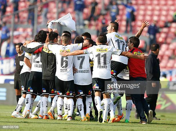 Players of Colo Colo celebrate after winning the match between U de Chile and Colo Colo as part of round 14 of Torneo Clausura 2014 at Nacional...