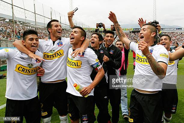 Players of Colo Colo celebrate victory after winning aginst U de Chile after a match between Colo Colo and U de Chile as part of the Torneo Apertura...