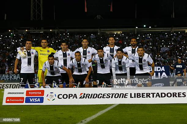 Players of ColoColo pose for a group photo prior to a group 1 match between ColoColo and Independiente de Santa Fe as part of group stage Copa...