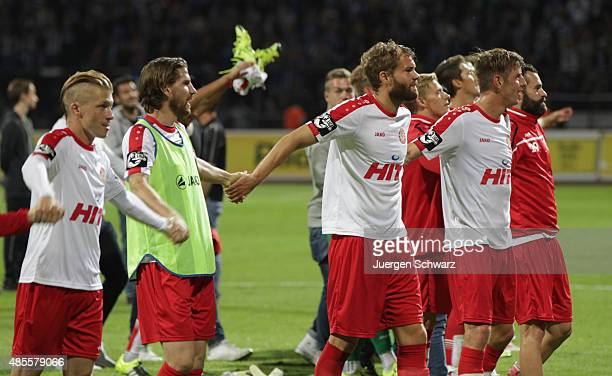 Players of Cologne celebrate in front of their supporters after the third Bundesliga match between Fortuna Koeln and 1 FC Magdeburg on August 28 2015...