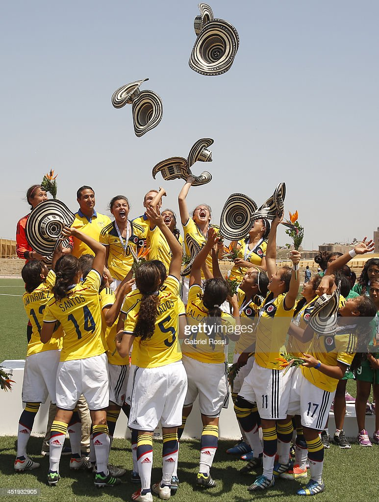Players of Colombia celebrate after wining the gold medal in a match between Colombia and Venezuela as part of the XVII Bolivarian Games Trujillo 2013 at Colegio San Jose on November 25, 2013 in Chiclayo, Peru.