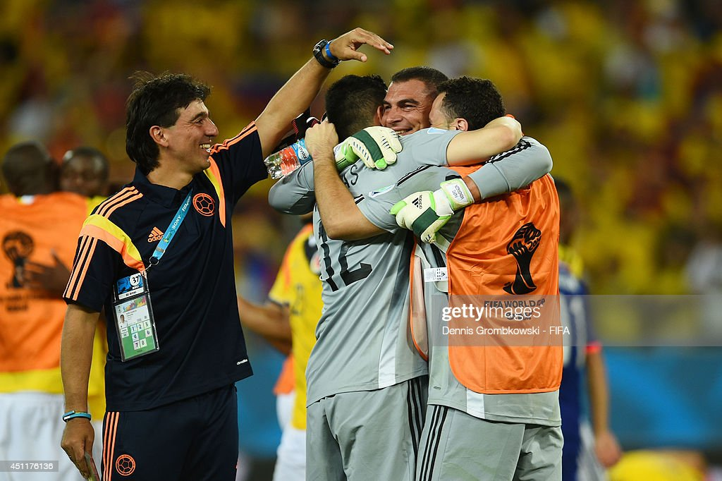 Players of Colombia congratualte <a gi-track='captionPersonalityLinkClicked' href=/galleries/search?phrase=Faryd+Mondragon&family=editorial&specificpeople=3449548 ng-click='$event.stopPropagation()'>Faryd Mondragon</a> of Colombia after the 2014 FIFA World Cup Brazil Group C match between Japan and Colombia at Arena Pantanal on June 24, 2014 in Cuiaba, Brazil.