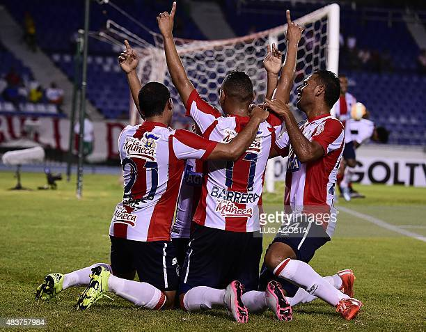 Players of Colombia´s Junior celebrate Hernandez's goal after scoring against Peru's Melgar during their 2015 Sudamericana Cup football match held at...