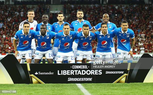 Players of Colombia's Millonarios pose before a Libertadores Cup football match against Brazilian Atletico Paranaense at the Arena da Baixada stadium...