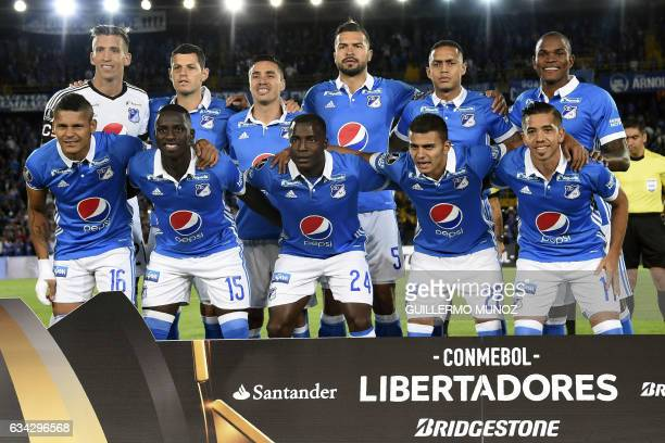 Players of Colombia's Millonarios pose before a Libertadores Cup football match against Brazil's Atletico Paranaense at the El Campin stadium in...