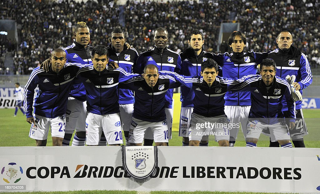 Players of Colombia´s Millonarios pose before their Copa Libertadores football match against Bolivia's San Jose at Jesus Bermudez stadium in Oruro, Bolivia, on March 14, 2013.AFP PHOTO/Aizar Raldes