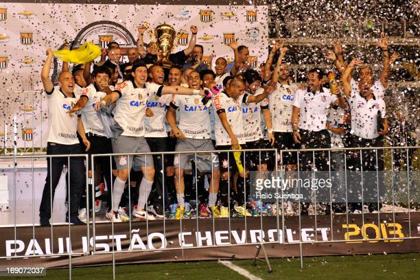 Players of Corinthians celebrate the title of the Paulista Championship 2013 after the match between Santos and Corinthians at Vila Belmiro Stadium...