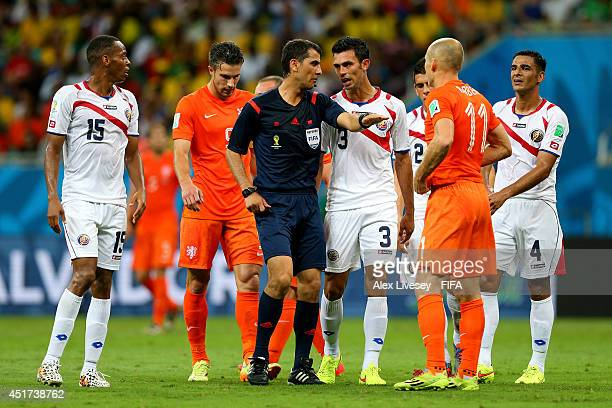 Players of Costa Rica and Netherlands appeal to referee Ravshan Irmatov during the 2014 FIFA World Cup Brazil Quarter Final match between Netherlands...