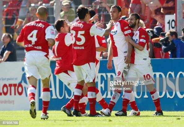 Players of Cottbus jubilate after team mate Emil Jula scored the first goal during the Bundesliga match between FC Energie Cottbus and Bayer 04...